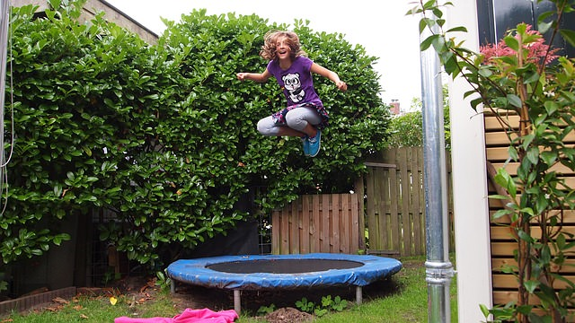 girl on mini trampoline