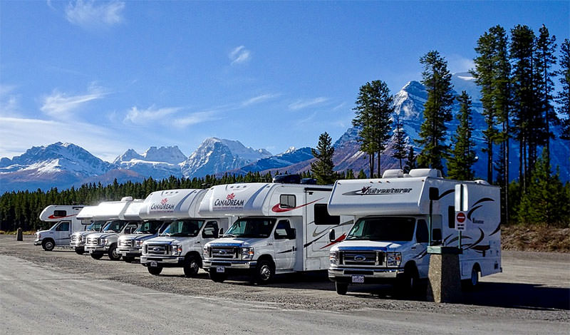 line of rvs in parking lot