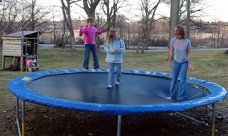 family on trampoline at home