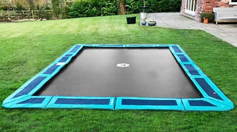 in-ground trampoline in backyard